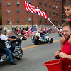 BANGOR, Maine -- 07/04/2017 - Dominic Saunders (right), 4, sits on the shoulders of his godfather, Wesley Woodard, during the annual Fourth of July parade from Brewer to downtown Bangor Tuesday. Ashley L. Conti | BDN