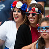 BANGOR, Maine -- 07/04/2017 - Ashley McAllister (from left), Whitney Bernard, and Trinity Umana, 8, watch the parade while wearing patriotic garb during the annual Fourth of July parade from Brewer to downtown Bangor Tuesday. Ashley L. Conti | BDN