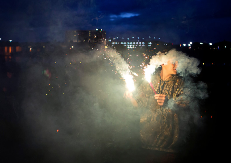 BREWER, Maine -- 07/04/2017 - Xavier Morrison, 14, plays with sparklers near the Brewer Waterfront before the annual Kiwanis fireworks show over the Penobscot River Tuesday. Ashley L. Conti   BDN