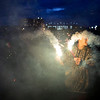 BREWER, Maine -- 07/04/2017 - Xavier Morrison, 14, plays with sparklers near the Brewer Waterfront before the annual Kiwanis fireworks show over the Penobscot River Tuesday. Ashley L. Conti | BDN