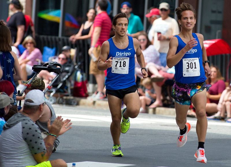 BANGOR, Maine -- 07/04/2017 - Adam Schwendt (right) and Adam Sukiennik battle for first during the 37th Annual Walter Hunt 4th of July 3K road race from Brewer to Bangor Tuesday. Schwendt and Sukiennik placed first and second respectively. Ashley L. Conti | BDN