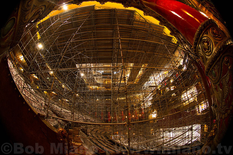 A fisheye view of scaffolding at the level of the balcony.