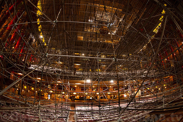Shot from the stage.  Scaffolding fills the entire theatre auditorium from the floor, past the balcony, all the way to the ceiling!