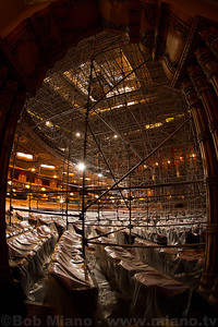 View from the side entrance to the main floor of the theatre with scaffolding stretching up to the ceiling.