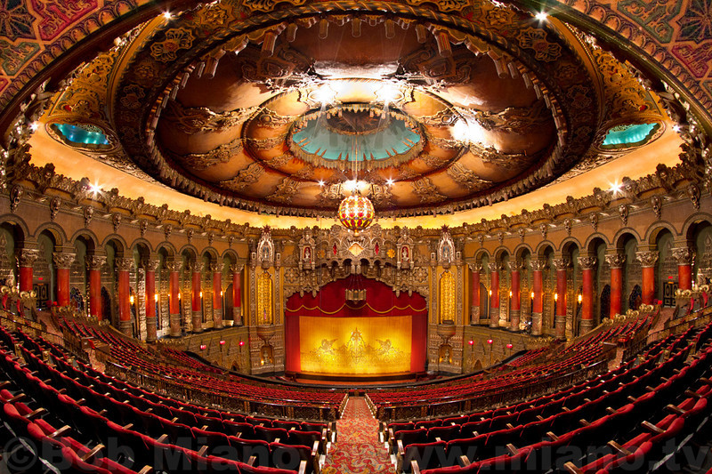 St. Louis' Fabulous Fox Theatre pre-renovation of the auditorium ceiling and lighting. Note the uneven lighting on the center ceiling and the burned-out incandescent lights in the blue alcoves on the left and right.  (All photos © miano.tv video production.)
