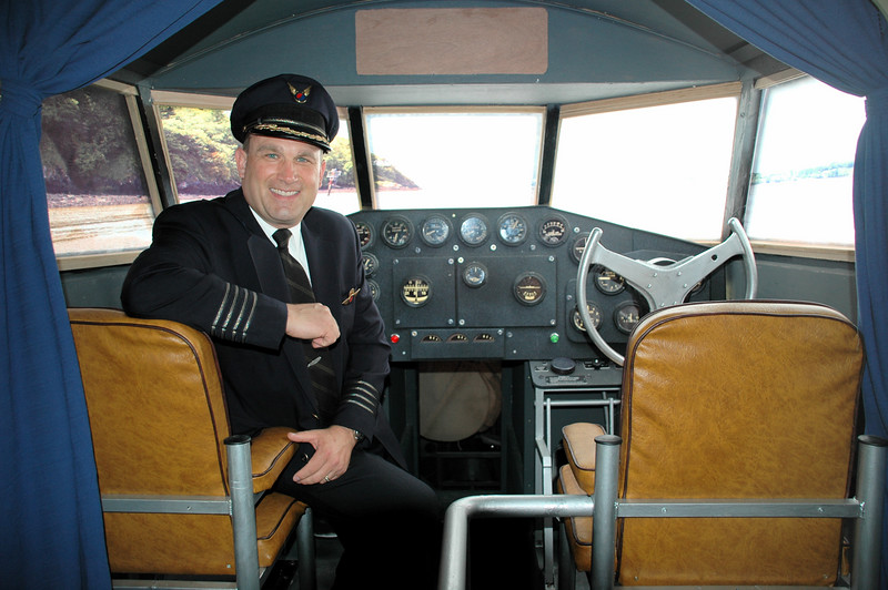 DSC_3167.JPG <br /> Capt. Jeff Johnston at the helm of our B-314