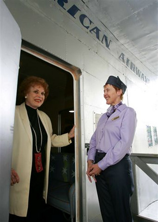 "Actress Maureen O'Hara and member of staff Helen Enright, at the doorway to the world's only full size replica of the Boeing 314, ""Yankee Clipper"", the main attraction in the newly renovated Foynes Flying Boat Museum in Foynes, Co. Limerick.  The renovation was opened by Arts, Sport and Tourism Minister John O'Donoghue TD - Photo : Kieran Clancy / PicSure ©  3/7/06"