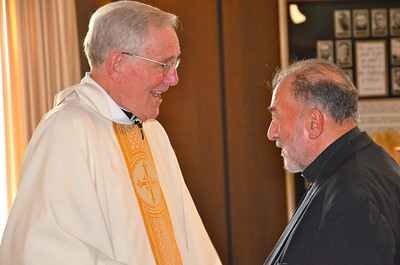 Receiving congratulations from Fr. Tony Russo, SCJ.