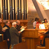 The seminary choir includes faculty and staff.