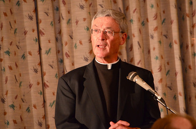 Fr. Tom Cassidy reading a letter of congratulations from the superior general of the Priests of the Sacred Heart.