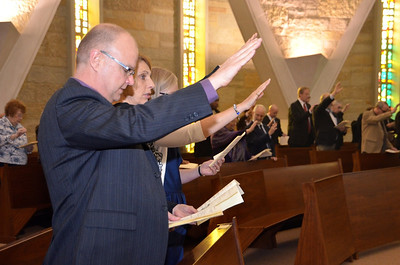 Members of Fr. Jan's family, visiting from Holland, extend their hands in blessing.