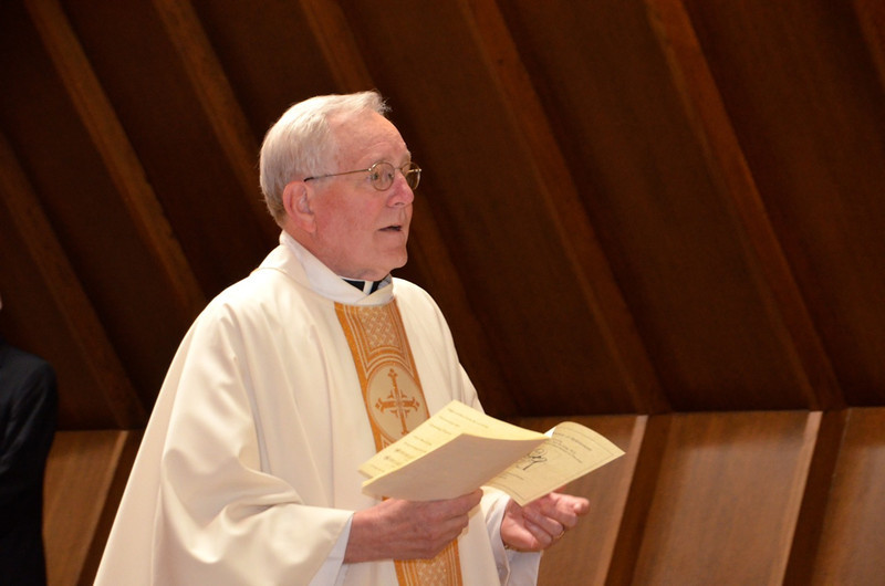 Fr. Jan processes into the chapel.