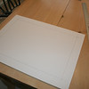 This is a foam board backer, cut to size, and then lines drawn to locate the picture.
