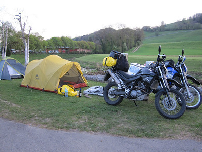 Camp by the river in Moudon, Switzerland. No bikes allowed, you say? James talked them round. Another ideal camp. Unless you have smellovision, you won't appreciate the freshly manured field opposite!