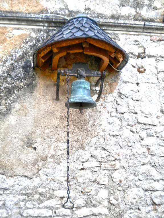 The dinner bell at Chateau de Touffou, Bonnes, France. They really ring it!