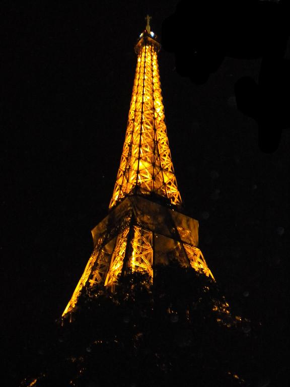 Eiffel Tower, Paris, France lit at night.