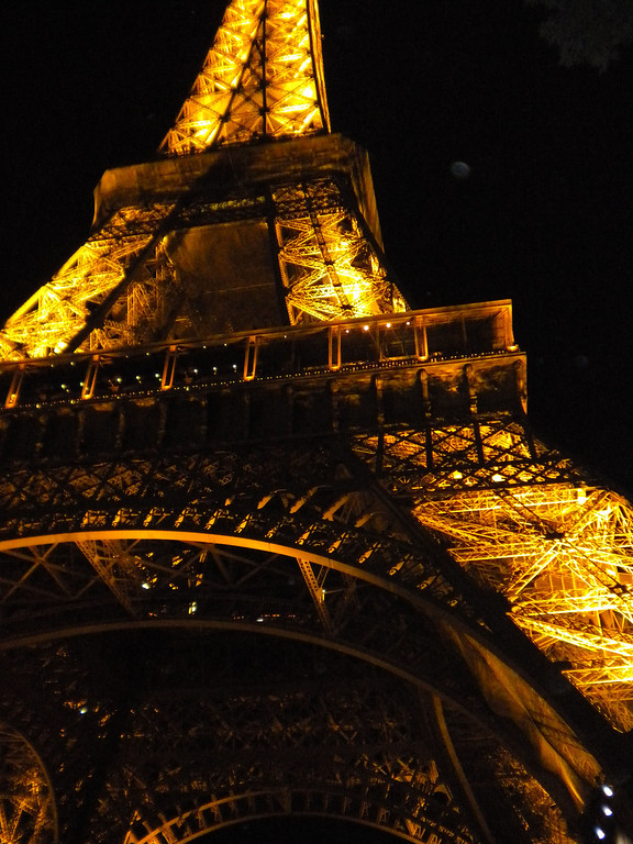 Eiffel Tower, Paris, France lit at night.