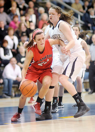 Frankton's Katie Key drives into the lane against Winchester's Delaney Miller in the sectional final at Shenandoah on Saturday.