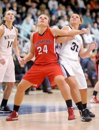Frankton's Natalie McGuire blocks out Winchester's Brandi Cross in the sectional final at Shenandoah on Saturday.