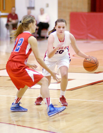 Don Knight / The Herald Bulletin<br /> Frankton's Payton Dellinger drives as she is guarded by Jay County's Mikayla Gross on Thursday.
