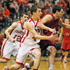 Connor Bates and his brother Cameron double team a Wapahani player at midcourt.