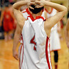 Frankton sophomore Cameron Bates places his hand on his head after the Eagles were defeated by Wapahani on a last-second tip-in.