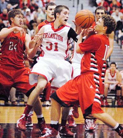 Frankton Eagle Austin Compton fights for an offensive rebound.