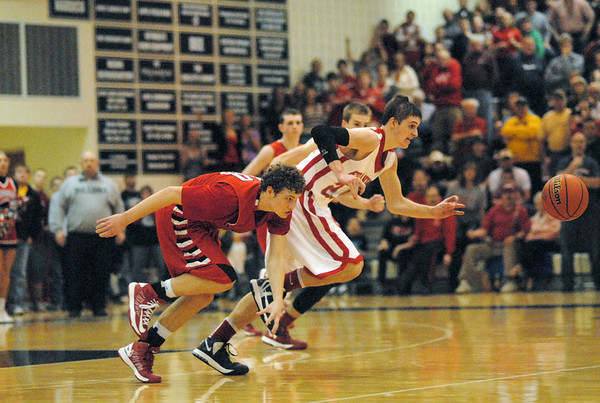 Trevor Hughes battles for a loose ball during the closing seconds of the fourth quarter of the Sectional championship game.
