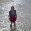 Dearne cooling her feet in the sand filtered fresh stream on Fraser Island