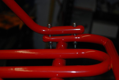 The steering column support with rubber insert between the tubes to damp vibrations and stainless fasteners (yet to be trimmed a little).