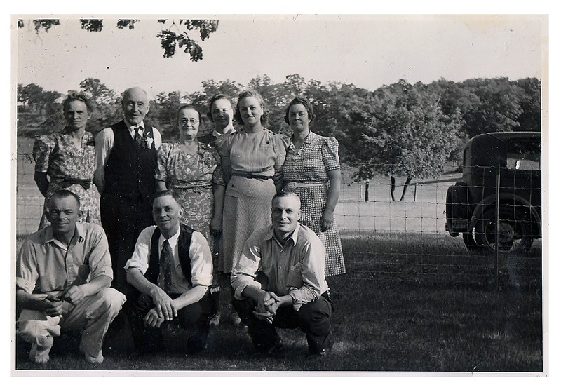 "(photo-ad) . . . Standing :: Judith , Claus , Marie , Sadie , Adelaide , Mabel.  ------  Front :: Rudy , Clarence , Elmer :: {identification from a similar photo in Bob & Rita Elmen's Fredine family history}.<br /> <br /> - - - {from Judy Iola, 2.jun.2013} :: ""I don't think my mother is in this photo. The first woman looks more like Rose, Swede's wife.""<br /> <br /> - - - Photo taken 1940 at Claus and Marie's 50th wedding anniversary celebration , Red Wing, Mn..<br /> <br /> - - - Scanned print size 3-1/8"" x 4-3/8"" with serrated edge.<br /> <br /> A note from Dave Stack - - - - With any of these photos, please feel free to comment at lower left or email me ds329ds@hotmail.com .<br /> <br /> - - - Jeanne, grand-daughter of Claus and Marie, had these photos in her collection. Please leave a note at lower left or email me if you can identify any unidentified person in any of the photos posted here in this website - and please, let me know if you notice any labeling errors. ---- Thanks - Dave Stack (great-grandson of Claus and Marie)."