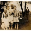 (photo-ar) . . . This photo was obviously taken at the same time and place as the previous photo.<br /> - Contains 4 of the same children as the previous photo.<br /> -- Rita says she thinks Ralph Anderson is the older boy standing in the back to the right.<br /> --- Dave thinks Jeanne, Spencer and Stan might be 3 of the children in this photo.<br /> ---- Laurie thinks that Jeanne, Spencer and Stan are not in photo.<br /> ----- These are most likely grandchildren of Marie's. And then as most likely cousins of Jeanne's, then who might they be?