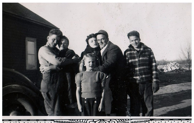 """(photo-cb) . . . {Partially obscured writing on back looks like} :: """"""""Mom & Pop - Mary Lou & Billy, Merle and Judy Iola"""""""".<br /> - """"""""Judy and Ole Hove and their children. this is possibly when they still lived in Staples"""""""" :: {from Darlene, 29.may.2013}.<br /> -- Scanned print size 2-3/4"""" x 3-3/4"""" with decorative border.<br /> --- Print sent to Judy Iola. :: {Dave}."""