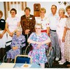 (photo-ba) . . . Standing= Mary -Judy Iola - Darlene - Sharon - Stan - Jeanne - Rita. - / / - Sitting= Judy Hove - Donna :: {from Bob & Rita Elmen's Fredine family history}.<br /> - 28 Aug 1993 -- Judith Fredine Hove's 95th birthday. --- Red Wing, Mn -- Fredine Family Reunion.<br /> - - In meeting room at Nybo's bowling alley, restaurant and bar.