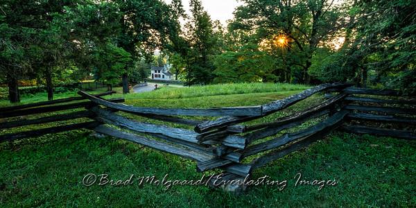 Sunrise fence and house scene.