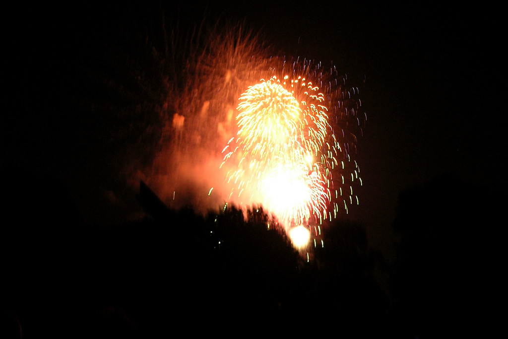 I love shooting fireworks.  July 4, 2004 Cranford NJ.<br /> Copyright 2006 John M. Cerra