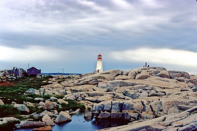 This light house is at Peggy's Cove, in Nova Scotia.  August 1979, Konica T-3 with a 50mm f1.7 on Kodachrome 64.  Cpyright 2006 John M. Cerra  Thanks