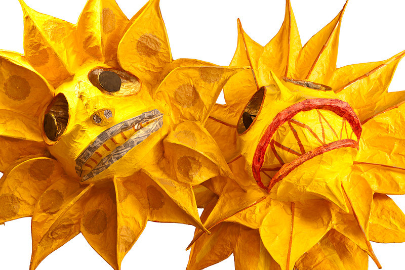Two paper mache decorations of the sun used as props for the annual Fremont Solstice Day Parade on June 9, 2012 in Seattle. The parade celebrates the start of summer on the Saturday on or immediately before the Solstice. (Isolated to a white background.)