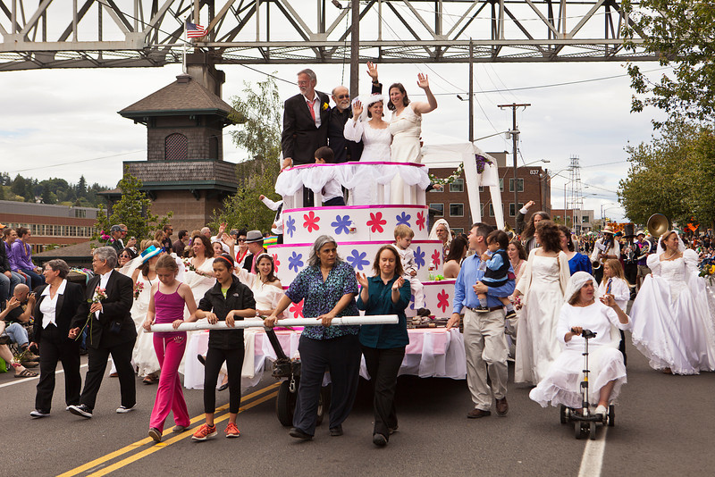 SEATTLE, WA - JUNE 16, 2012: A parade float built like a wedding cake celebrates the initiative in Washington State for same sex marriages between gays and lesbians during the 2012 Annual Fremont Summer Solstice Parade in Seattle on June 16, 2012. The parade celebrates the start of summer on the Saturday on or immediately before the Solstice.