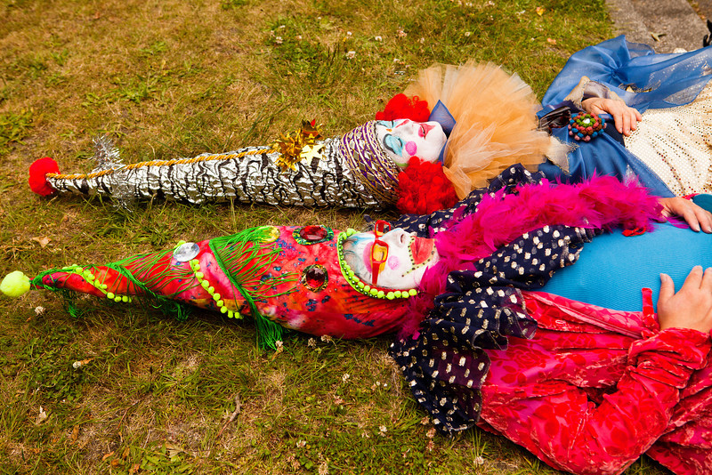 SEATTLE, WA - JUNE 16, 2012: Two members of the Jaberwokey performance ensemble resting after walking in the annual Fremont Summer Solstice Parade on June 16, 2012 in Seattle. The parade celebrates the start of summer on the Saturday on or immediately before the Solstice.