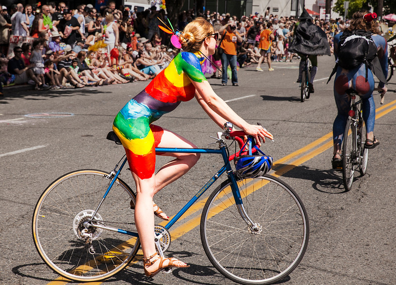 Painted Cyclist In Rainbow