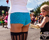 SEATTLE, WA - JUNE 22, 2013: A young girl gazes at the outfit of the assistant to the master of ceremonies during the 2013 Annual Fremont Summer Solstice Parade in Seattle on June 22, 2013. The parade celebrates the start of summer in Seattle.