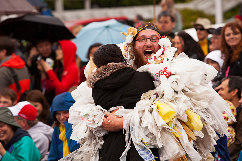 Seattle, Washington - June 18, 2011:  A man, part of the Nuclear Waste Freak Show ensemble, is hugging a bystander during the 2011 Annual Fremont Summer Solstice Day Parade. The parade celebrates the summer solstice and features a number of alternative, non-traditional artistic ensembles.