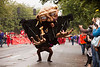 Seattle, Washington - June 18, 2011:  An enormous creature walks down the parade route for the annual Fremont Summer Solstice parade. The parade celebrates the summer solstice and features a number of alternative, non-traditional artistic ensembles.