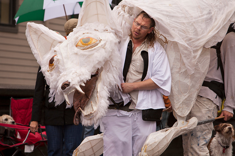 Seattle, Washington - June 18, 2011:  A giant wolf puppet and his puppeteer are featured in the ensemble Giant Puppets Save The World during the 2011 Annual Fremont Summer Solstice Day Parade. The parade celebrates the summer solstice and features a number of alternative, non-traditional artistic ensembles.