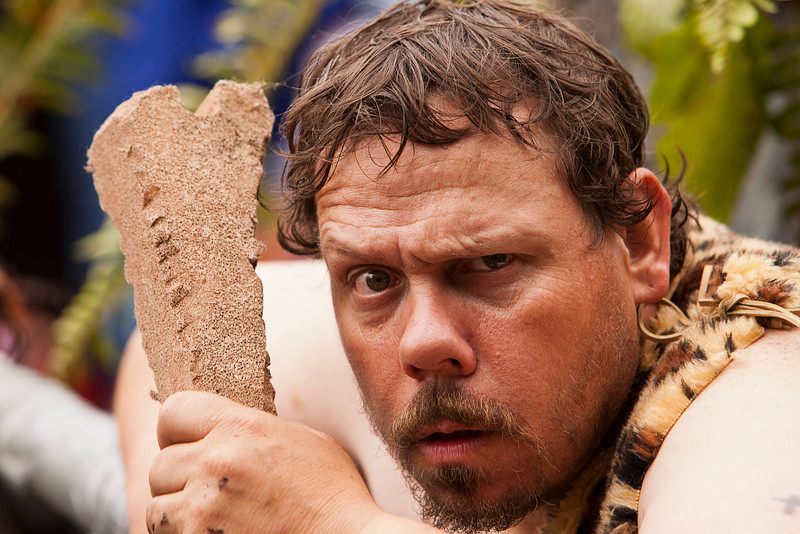 Seattle, Washington - June 18, 2011:  A member of the Caveman Discovers Cannabis group at the annual Fremont Solstice Day Parade. The parade celebrates the summer solstice and features a number of alternative, non-traditional artistic ensembles.