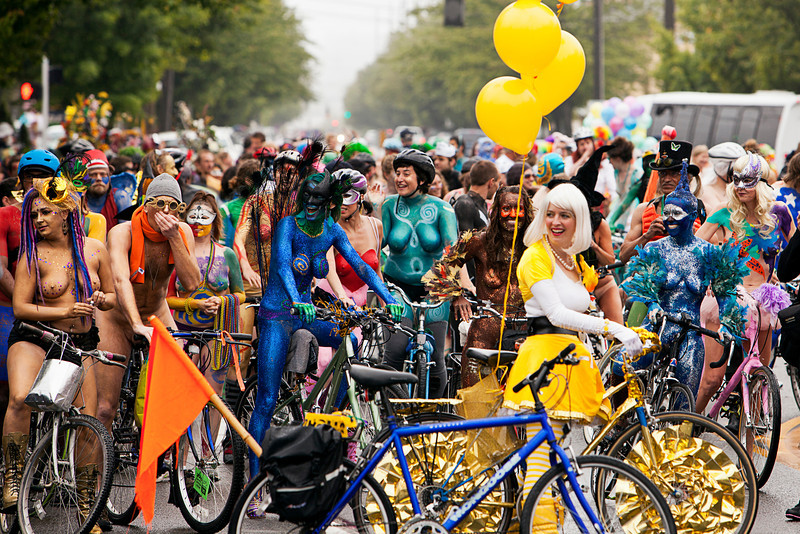 Seattle, Washington - June 18, 2011:  Naked bicyclists throng the start of the annual Fremont Solstice Day Parade. The parade celebrates the summer solstice and features a number of alternative, non-traditional artistic ensembles.