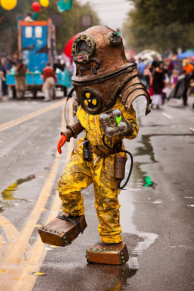 Seattle, Washington - June 18, 2011:  A member of the Nuclear Summer ensemble in a diving suit lurches across the parade route at the annual Fremont Solstice Day Parade. The parade is held to celebrate the summer solstice and features a number of alternative, non-traditional artistic ensembles.