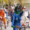 Seattle, Washington - June 18, 2011:  Naked bicycle riders are featured at the start of the annual Fremont Solstice Day Parade. A topless women is covered in blue body paint to look like a peacock with feathers. The parade celebrates the summer solstice and features a number of alternative, non-traditional artistic ensembles.
