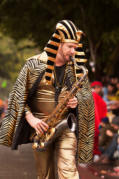 Seattle, Washington - June 18, 2011:  King Tut plays the saxophone while marching in the 2011 Annual Fremont Summer Solstice Day Parade. The parade celebrates the summer solstice and features a number of alternative, non-traditional artistic ensembles.